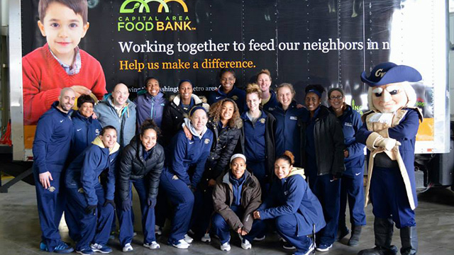 GW student athletes donate their time to a local food bank.