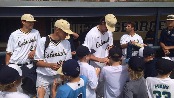 GW Baseball serving as mentors for kids on the field.