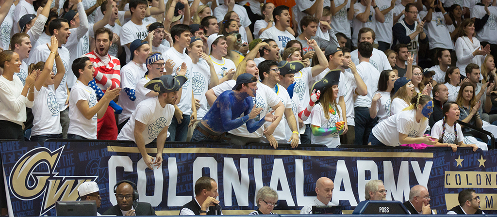 Students cheering at a basketball game