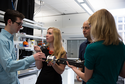 Professor Megan Leftwich works with students in a SEAS lab.