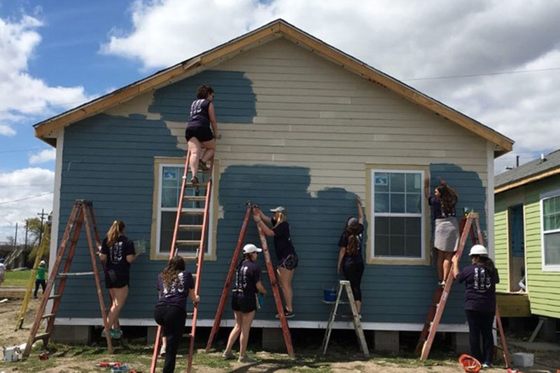 "Students help in building a house for ""Homes for humanity."""
