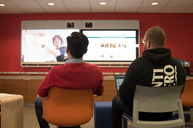 STEMworks sudents get a life-size presentation on the state-of-the-art TelePresence.