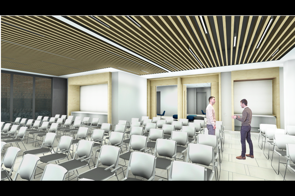 Rendering of the first floor assembly area of the GW Hillel building with rows of single chairs.