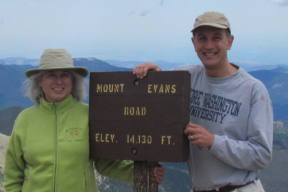 Taking GW to the top: Jerry Tinianow, BA '77, JD '80, wears his GW pride at the summit of Mt. Evans with his wife, Sharon.