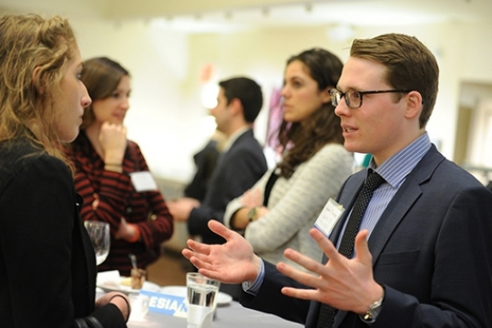 Students and Alumni network at an Elliott School event.